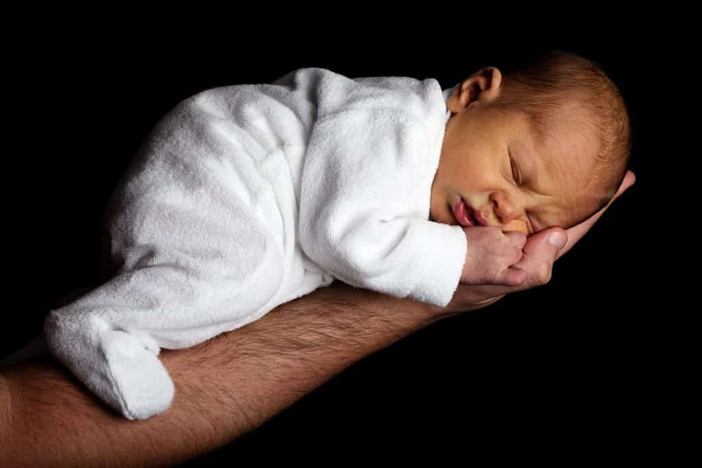newborn sleeping on side